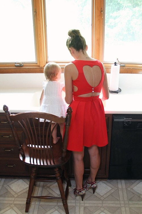 mother wearing red dress and daughter